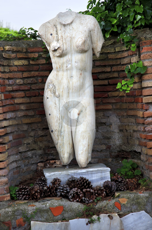 Ancient Roman Nude Woman Statue Ostia Antica Rome Italy stock photo, Ancient Roman NUde Woman Statue Ostia Antica Ruins Rome Italy Excavation of Ostia, ancient Roman port, next to airport.  Was port for Rome until 5th Century AD.  by William Perry