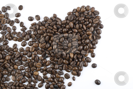 Coffee beans heart stock photo, scattered coffee beans forming a shape of a heart  by vanmaracic