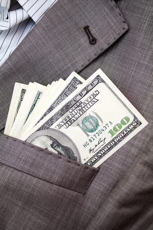 Dollars in the pocket of business suit stock photo, one hundred dollars in the pocket of business suit by Illustrart