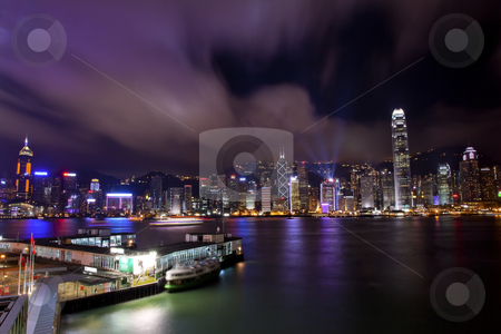 Hong Kong Harbor at Night from Kowloon Ferry stock photo, Hong Kong Harbor at Night  With Trademarks May 8, 2011 from Kowloon Star Ferry Reflection by William Perry