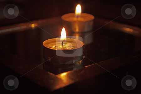 Candles stock photo, Close up of a candle, with another on the back by Fabio Alcini