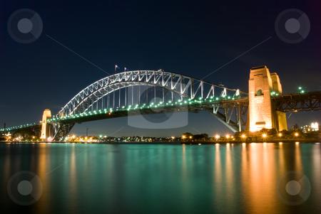 Sydney Harbour Bridge By Night stock photo, Sydney Harbour Bridge By Night with sparkling water reflection by mroz