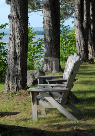 Two chairs stock photo, Two Adirondak chairs overlooking the lake. by Tim Markley