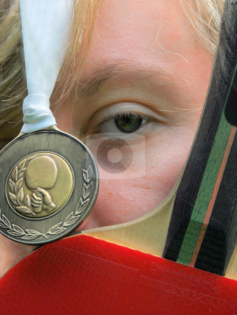 Table Tennis Gold stock photo, A Young Female with Table Tennis Bat and Gold Medal. by Lucy Clark