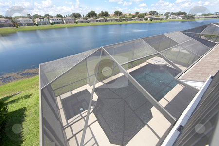 Swimming Pool View stock photo, A Swimming Pool and Spa overlooking a Lake by Lucy Clark