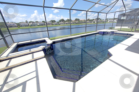 Swimming Pool stock photo, A Swimming Pool with a Lake View by Lucy Clark