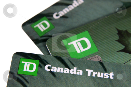TD Bank Cards stock photo, Toronto, Ontario, Canada - July 2, 2011: A closeup of three TD Canada Trust bank cards.  TD Canada Trust is one of the biggest banks in Canada.  They also operate internationally. by Chris Hill