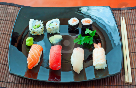 Sushi stock photo, Black plate with different kind of sushi  by Fabio Alcini