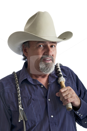 Cowboy with bullwhip on his shoulder stock photo, Cowboy holding a bullwhip around his shoulder. Isolated on white by RCarner Photography