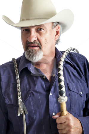 Cowboy with bullwhip ready to work stock photo, Cowboy holding a bullwhip around his shoulder. Isolated on white by RCarner Photography
