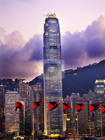 Two Intrnational Finance Centre Hong Kong Sunset Red Flags from  stock photo, Two International Finance Centre Hong Kong Harbor Sunset Red Flags from Kowloon by William Perry
