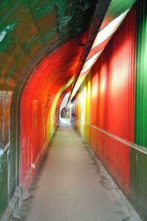 Footpath tunnel stock photo, colorfully, gayfully, fascinatingly painted walls of an underground city walkway by Toyashoo