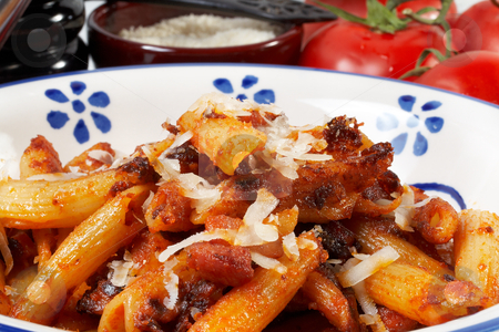 Fried pasta stock photo, a plate of fried maccheroni with tomato, bacon and olive oil by maxg71