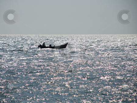 Boat and Glittering Sea stock photo, Fishermen are returning in the afternoon. by selimgoksu