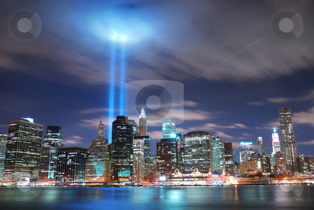 New York City Manhattan at night stock photo, Remember September 11. New York City Manhattan panorama view at night with office building skyscrapers skyline illuminated over Hudson River and two light beam in memory of September 11. by rabbit75_cut