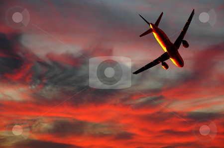 Air travel - plane and sunset stock photo, Plane is flying while the sun is setting by Lars Christensen