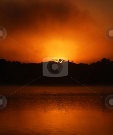 Sunrise at Xul.Ha stock photo, In the shores of the Bacalar Lake, this beautiful sunrise in the town of Xul-Ha, Quintana Roo, Mexico by esetotol