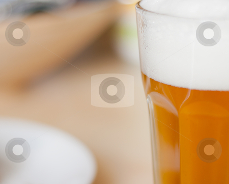 Glass of Beer on Table stock photo, Detail of Draugt Beer in Glass on Table in Restaurant by JAMDesign