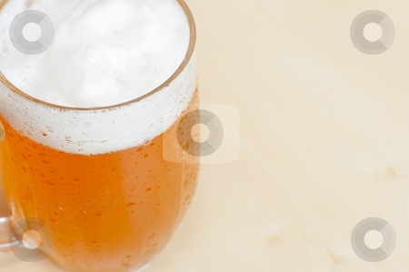 Draught Beer on the Table stock photo, Detail of Draught Beer on the Wooden Table in Restaurant by JAMDesign
