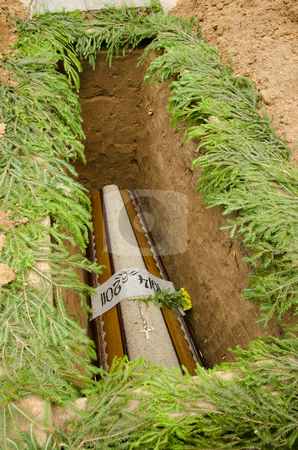 The coffin lowered into pits.  stock photo, The coffin lowered into pits. Sometimes death visit us suddenly. by sauletas
