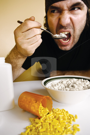 Drug addiction stock photo, A man feeding himself medication with a spoon. Metaphor for addiction, dependency, etc.  by © Ron Sumners