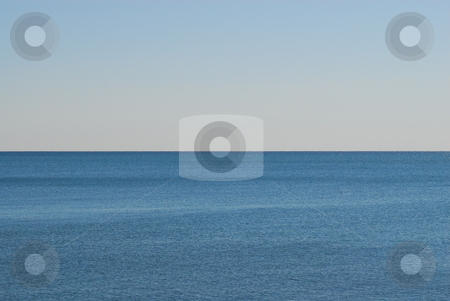 Empty water horizon stock photo, Empty blue water with ripples against horizon. by ArchonCodex