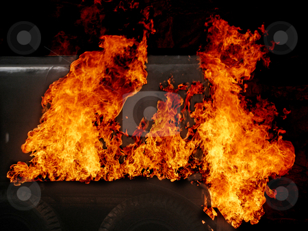Fire stock photo, The back on a truck on fire with big flames by Lucy Clark