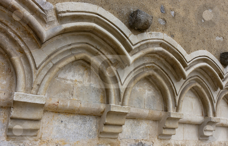 Gothic arches on a wall stock photo, cascade of traditional gothic arches with simple archivolts on a religious building wall by Alexander Pastukh