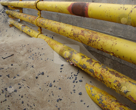 Detail of a yellow industrial rusty pipeline                     stock photo, detail of a yellow industrial rusty pipeline                                by johnjohnson