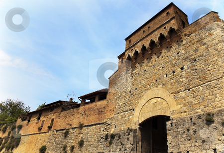 Ancient Stone Gate Arch Medieval Town Castle San Gimignano Tusca stock photo, Ancient Stone Gate and Wall with Coats of Arms Arch Medieval Town Castle San Gimignano Tuscany Italy by William Perry