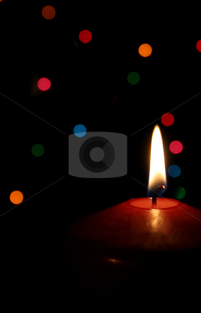 Christmas Candle stock photo, A single lit red Christmas candle.  by Chris Hill