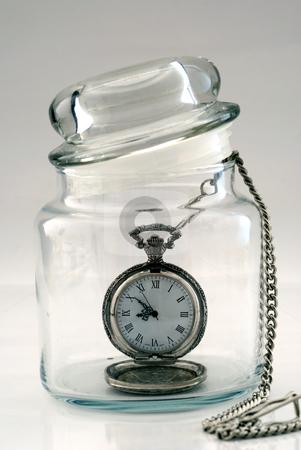 Old pocket watch in a glass jar – Time in a Bottle stock photo, Old pocket watch in a glass jar – Time in a Bottle by johnkwan