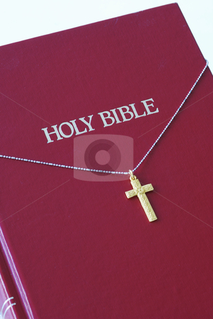 A golden cross on the top of a red bible stock photo, A golden cross on the top of a red bible by johnkwan