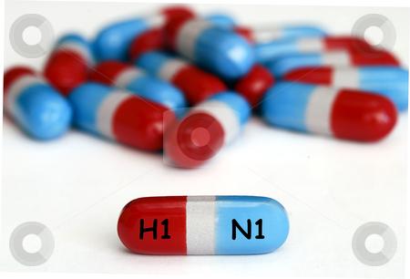 Swine Flu (H1N1) pills isolated on white stock photo, Swine Flu (H1N1) pills isolated on white by johnkwan