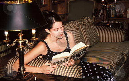 Woman reading a book stock photo, Attractive woman reading a book by Anthony Dezenzio