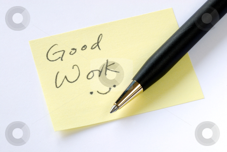 Write the words Good Work on a yellow sticky note stock photo, Write the words Good Work on a yellow sticky note by johnkwan