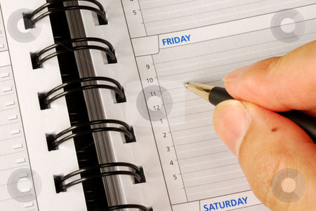 Write down what to do on Friday in the day planner  stock photo, Write down what to do on Friday in the day planner  by johnkwan