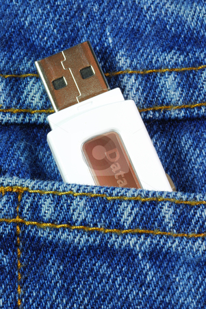 USB flash memory jump drive in a jeans pocket concepts of data mobility stock photo, USB flash memory jump drive in a jeans pocket concepts of data mobility by johnkwan