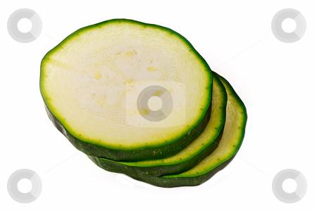 Zucchini stock photo, Three slices of fresh and green zucchini by kalnina