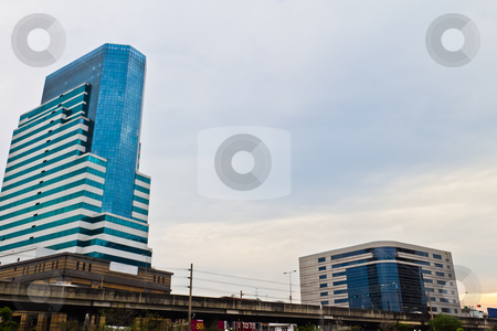 Urban high-rise building in the evening. stock photo, Urban high-rise building in the evening. by Na8011seeiN