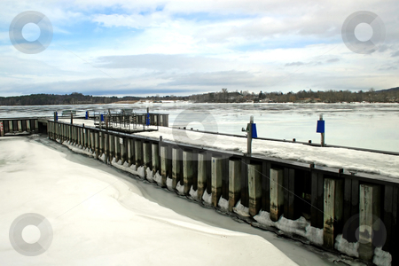 Ice Lake stock photo, A dock and lake iced over in the winter by Lucy Clark