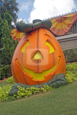 Pumpkin with jack o'latern face stock photo, A big pumpkin with a happy smiling face by Lucy Clark