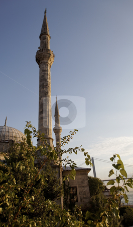Hamid Vapur Cami from the banks of Bosphorus River stock photo, Hamid Vapur Cami from the banks of Bosphorus River, mosque and calling for prayer tower with Bogazici Kpr bridge in the background, vertical, blue sky, sunny day, crop area and copy space by Kantilal Patel