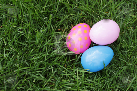 Find the easter eggs stock photo, Easter eggs hidden in the grass for children to find on Easter. by photolady