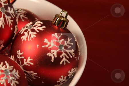 Red Xmas Ball stock photo, A closeup of red baubles sitting in a bowl.  by Chris Hill