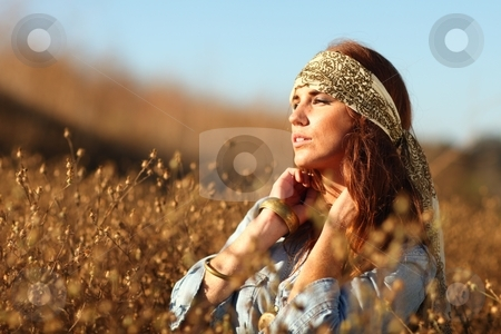 Beautiful Woman on a Field in Summertime  stock photo, Young Beautiful Woman in a Field During Summertime by Katrina Brown
