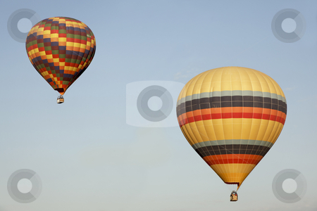 Two multi-colored balloons blue sky stock photo, two colorful hot air balloons high in a light blue sky, horizontal, copy space by Kantilal Patel