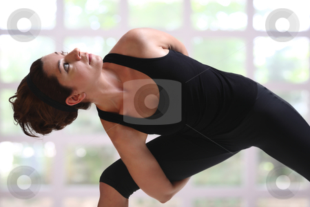 Pretty girl in yoga time stock photo, Young girl in black practice yoga and relaxation by Roberto Giobbi