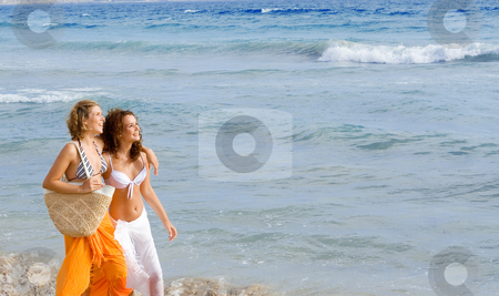 Young women walking along beach on spring break or summer vacation stock photo, young women walking along beach on spring break or summer vacation by mandygodbehear