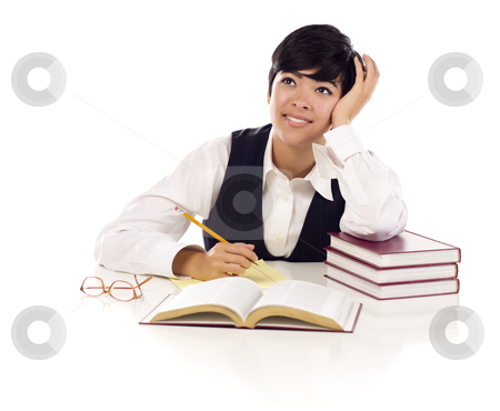 Daydreaming Mixed Race Female Student with Books Isolated stock photo, Daydreaming Mixed Race Young Adult Female At White Table with Books Looking Up and Away Isolated on a White Background. by Andy Dean
